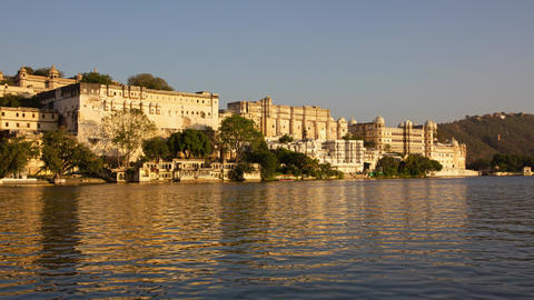 Palace on lake in Udaipur, India, day to night Footage