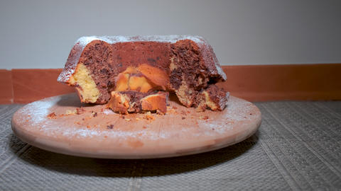Traditional marble cake on wooden plate Footage