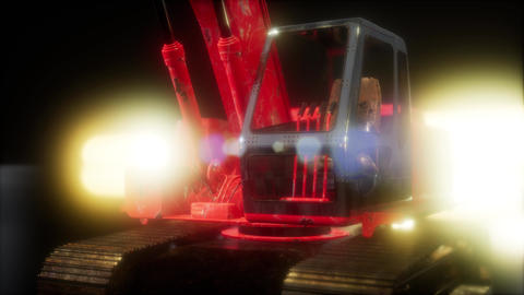 excavator in the dark with bright lights Footage