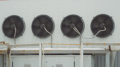 Industrial air conditioning system. Large fans on wall of the building Archivo
