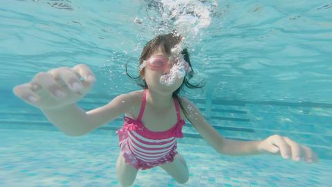 cute girl in swimming pool Footage