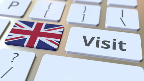 VISIT text and flag of Great Britain on the buttons on the computer keyboard Footage