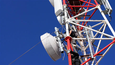 Workers working on the installation of telecommunication antennas climb to great Live Action