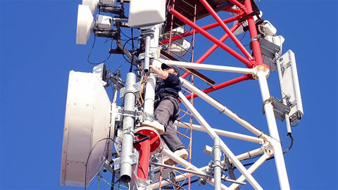 Workers working on the installation of telecommunication antennas climb to great Footage