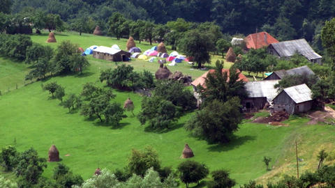 Tent camp conducted on land surrounded by trees and homes 01 Footage
