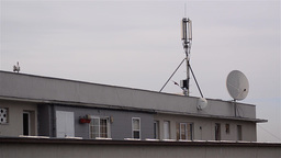 Upper terrace of a building where an antenna is mounted on walks where only bird Footage