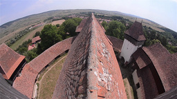 View over the nave of a church steeple and fortified walls that surround 02 Footage