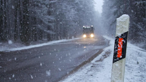 Movement of Vehicles in Difficult Weather Conditions. snowy day Footage