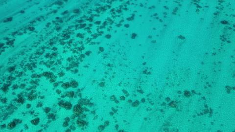 French Polynesia Tahiti aerial view of island motu coral reef lagoon by Huahine Live Action