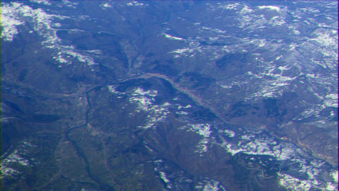 Glitch effect. The river and the city in the mountains. View from the airplane GIF