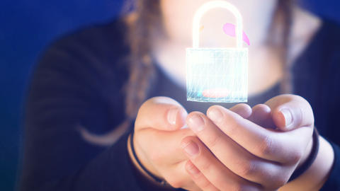 teenage girl with braids, holding a digital lock in her hands, ideal for themes Archivo