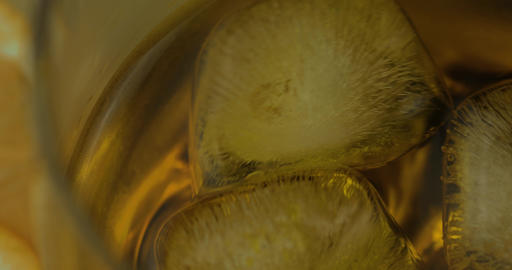 Whiskey with ice cubes in drinking glass. Glass of rum alcohol Footage