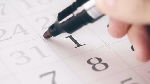 Marked date in the calendar transforms into NEW YEAR text Footage