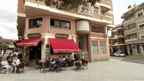 People eating and drinking at Bar ビデオ