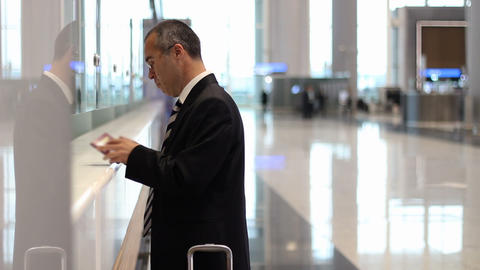 Passenger business man passenger at the airport check in desk, receive a flight ticket Footage