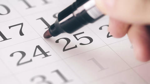 Marked the twenty-fifth 25 day of a month in the calendar transforms into SAVE Footage