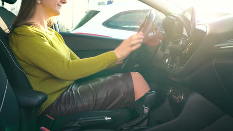 Woman fastening car safety seat belt while sitting inside of vehicle before Footage