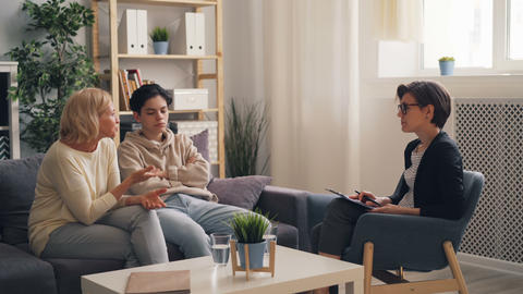 Worried parent mature woman discussing parenting problems with therapist Live Action