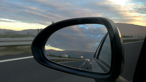 Highway view from car rear view mirror Live Action
