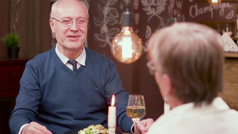 Old man gets a present from his wife on a anniversary date Footage