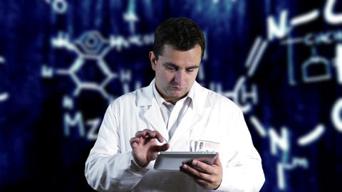 Scientist using Tablet PC with Scientific Chemistry Background 7 Footage