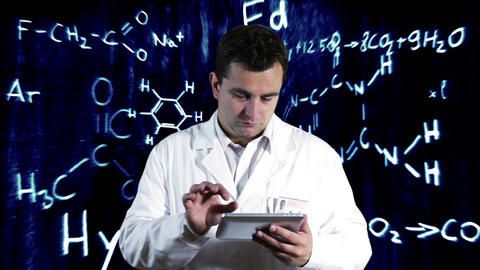 Scientist using Tablet PC with Scientific Chemistry Background 11 Footage
