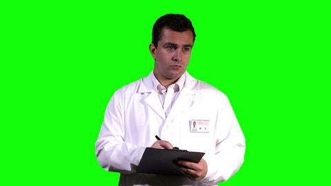 Young Doctor Making Notes Touchscreen Greenscreen 14 Stock Video Footage