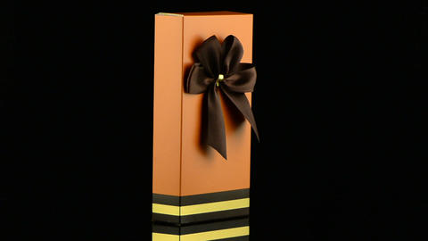 Orange box with gold bow Footage