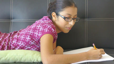 Young woman writing Stock Video Footage