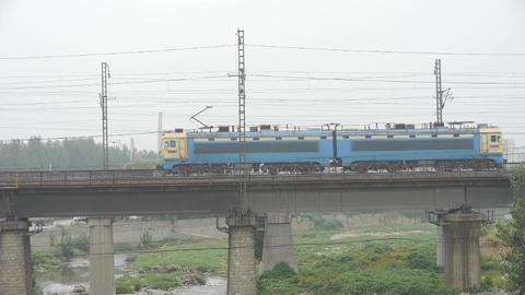 Long goods train traveling on railway Bridge Stock Video Footage