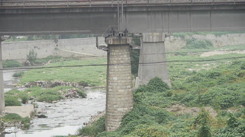 Pollution rivers,in the side of road bridge Stock Video Footage
