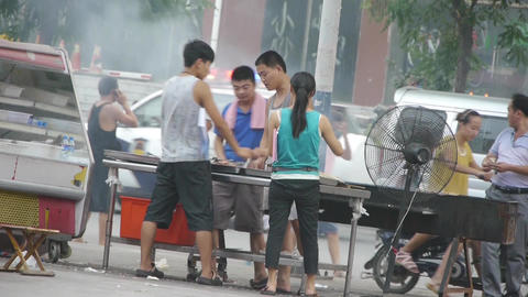 Street barbecue,busy vendors Footage