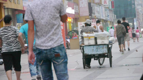 traders seller pushing a tricycle in street,on Urban town... Stock Video Footage