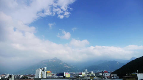 Clouds on top of hill,City buildings close relying on... Stock Video Footage