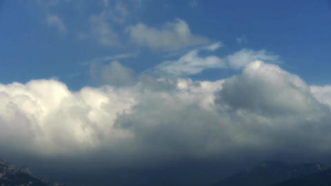 Clouds on top of hill & mountain Stock Video Footage