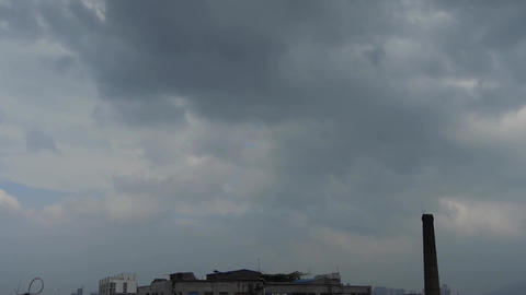 Spectacular clouds cover sky,City factory... Stock Video Footage