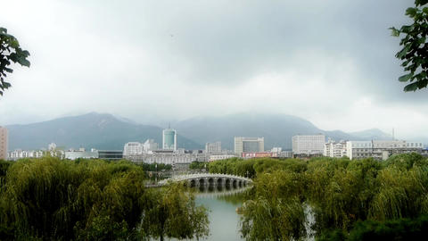 Arch bridge on lake in willows Park.City rely on distant... Stock Video Footage