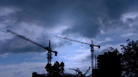 Construction-cranes,clouds cover sky,building... Stock Video Footage