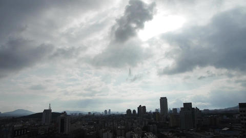 Cloud over High-rise.City buildings relying on... Stock Video Footage