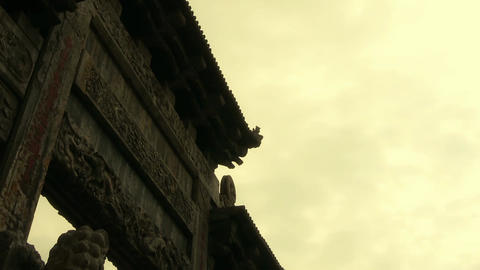 China stone arch & ancient eaves.Majestic looking up angle Footage