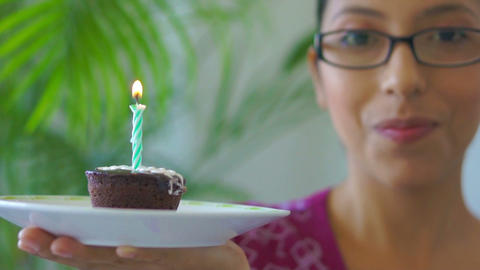 Blowing out a candle Stock Video Footage