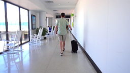 Airline Passenger Walking Down Airport Hallway Footage