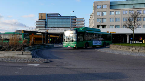 Green Buses Arriving At The Bus Terminal stock footage