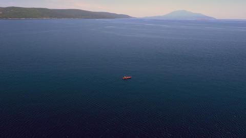 Aerial - Tracking shot of three people kayak paddling Footage