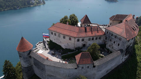 Aerial, Slow Motion - Majestic Bled Castle Above The Lake stock footage