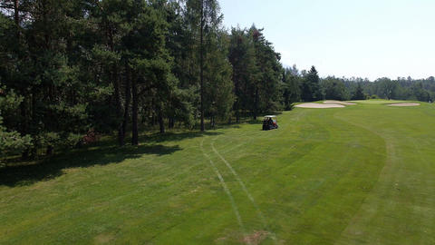 Aerial, slow motion - Buggy driving from the rough area of the course Footage