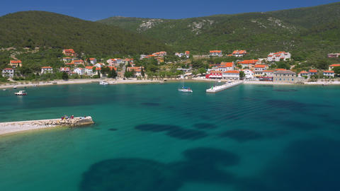 Aerial - Coastal town with beautiful blue water Footage