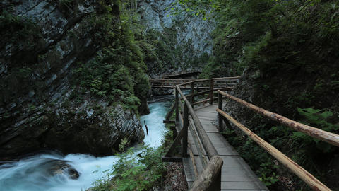 Timelapse - Bridge path over the river in a canyon Footage