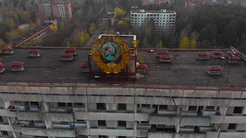 Soviet coat of arms on a building in Pripyat Live Action