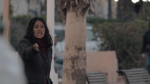 Weird woman beggar in the street Archivo